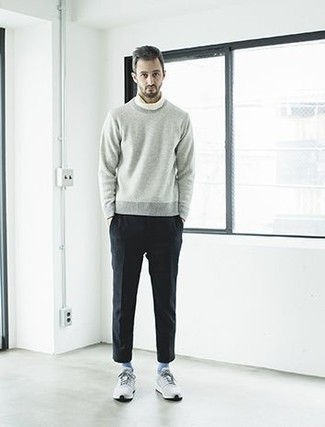 Socks Outfits For Men: The versatility of a grey crew-neck sweater and socks ensures you'll always have them on heavy rotation in your wardrobe. Consider a pair of grey athletic shoes as the glue that ties your look together.