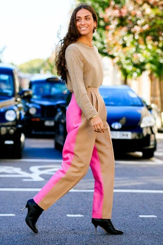 How to wear: tan crew-neck sweater, hot pink wide leg pants, black leather ankle boots, gold bracelet