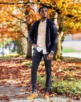 Beige Crew-neck Sweater Fall Outfits For Men In Their 20s: Marry a beige crew-neck sweater with navy jeans to create a really sharp and current casual outfit. Tobacco suede chelsea boots will instantly lift up even the most casual of ensembles. This one is a savvy choice when it comes to figuring out a well-coordinated look for unpredictable fall weather. All in all, a nice idea if we're talking fashion for 20-something men.