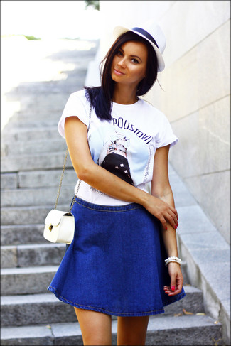 Go for a white print crew-neck tee and a blue denim a-line skirt for a casual coffee run.
