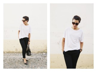 This combo of a white crew-neck t-shirt and black capri pants embodies comfort and versatility. When it comes to footwear, this ensemble is round off perfectly with black studded leather ballerina shoes. You totally can to remain fresh and pulled-together under the scorching heat, and this ensemble is proof of just that.