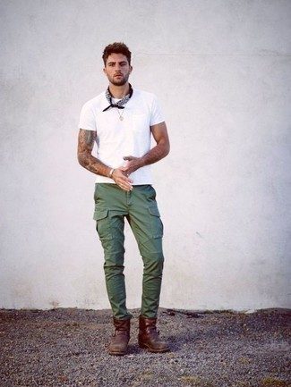 How to Wear Dark Green Cargo Pants: A white crew-neck t-shirt and dark green cargo pants are the perfect way to introduce some cool into your off-duty rotation. If you wish to instantly perk up your outfit with a pair of shoes, why not complete this ensemble with burgundy leather chelsea boots?