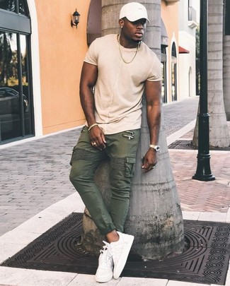 How to wear: beige crew-neck t-shirt, olive cargo pants, white leather low top sneakers, white baseball cap