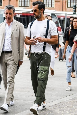 How to Wear Dark Green Cargo Pants: This city casual pairing of a white print crew-neck t-shirt and dark green cargo pants is very easy to put together without a second thought, helping you look amazing and prepared for anything without spending a ton of time searching through your wardrobe. Feeling brave? Jazz things up by sporting white and black leather low top sneakers.