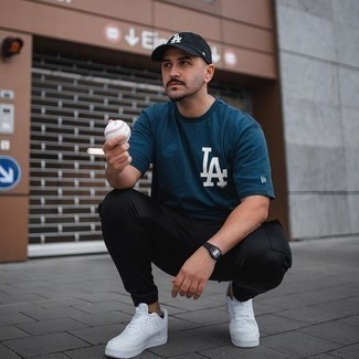 Black Rubber Watch Outfits For Men: For a relaxed getup with a clear fashion twist, you can easily go for a teal print crew-neck t-shirt and a black rubber watch. Balance out this outfit with a more polished kind of shoes, like these white canvas low top sneakers.