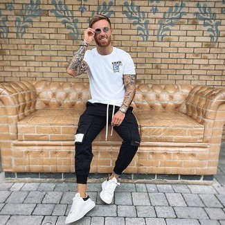 Silver Sunglasses Outfits For Men: For relaxed dressing with a twist, reach for a white print crew-neck t-shirt and silver sunglasses. Perk up your ensemble by finishing off with white and black leather low top sneakers.