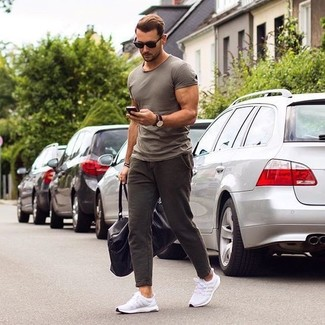 This combination of a grey crew-neck t-shirt and dark brown chinos is very versatile and really up for any sort of adventure you may find yourself on. Mix things up by wearing white running sneakers. As you can see, this is a neat option for summertime.