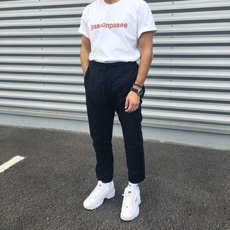 How to Wear a White and Red Print Crew-neck T-shirt For Men: For something more on the casual end, try teaming a white and red print crew-neck t-shirt with black chinos. And if you want to easily dress down this ensemble with a pair of shoes, why not add a pair of white athletic shoes?