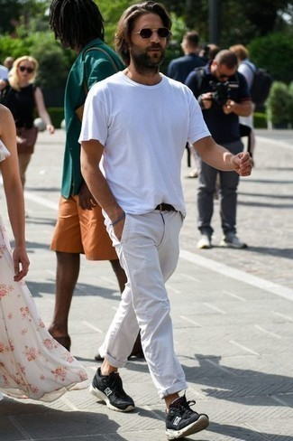 How to Wear White Chinos: If the situation permits off-duty dressing, consider pairing a white crew-neck t-shirt with white chinos. Complement this look with a pair of black and white athletic shoes to keep the getup fresh.