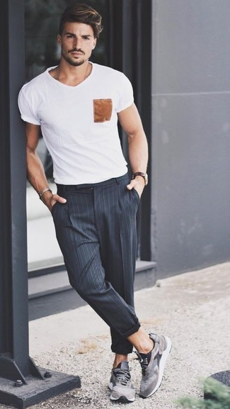 How to Wear Navy Vertical Striped Chinos: This combination of a white print crew-neck t-shirt and navy vertical striped chinos is irrefutable proof that a pared down casual look can still be really interesting. Grey athletic shoes are a simple way to give a dose of stylish nonchalance to this ensemble.