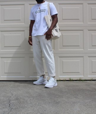 1200+ Relaxed Outfits For Men: Parade your credentials in menswear styling by marrying a white print crew-neck t-shirt and white chinos for a casual getup. A trendy pair of white athletic shoes is an easy way to transform your ensemble.