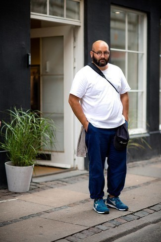 White No Show Socks Outfits For Men: Try pairing a white crew-neck t-shirt with white no show socks for an unexpectedly cool ensemble. Puzzled as to how to round off this getup? Rock a pair of blue athletic shoes to amp it up a notch.