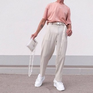 1200+ Outfits For Men After 40: This casual combo of a pink crew-neck t-shirt and beige chinos is a goofproof option when you need to look cool in a flash. Give a dressed-down feel to your outfit by wearing a pair of white athletic shoes. So as you can see, as a mature guy, you have a wide array of styling options.