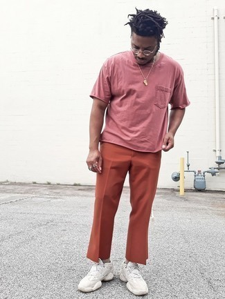 Pink Crew-neck T-shirt Outfits For Men: This casual combo of a pink crew-neck t-shirt and orange chinos is ideal when you want to feel confident in your look. Play down the formality of this outfit by rounding off with beige athletic shoes.