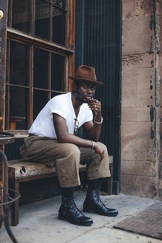 Boots Outfits For Men: Want to infuse your wardrobe with some effortless cool? Consider wearing a white crew-neck t-shirt and khaki wool chinos. A pair of boots easily ramps up the style factor of this ensemble.