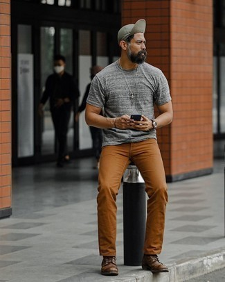 Tobacco Chinos Outfits: A grey crew-neck t-shirt and tobacco chinos make for the ultimate relaxed casual getup for any gentleman. Why not complete this look with a pair of dark brown leather casual boots for an extra dose of style?