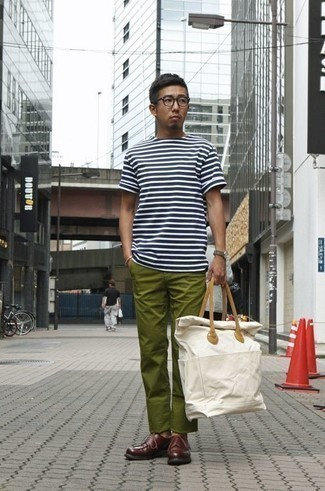 White Canvas Tote Bag Outfits For Men: A white and navy horizontal striped crew-neck t-shirt and a white canvas tote bag are absolute menswear must-haves that will integrate nicely within your off-duty styling lineup. A pair of burgundy leather derby shoes easily classes up the look.