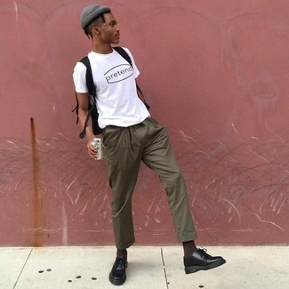 Men's Outfits 2021: A white and black print crew-neck t-shirt and olive chinos are the kind of a no-brainer off-duty look that you so awfully need when you have no time to spare. Serve a little outfit-mixing magic by sporting a pair of black chunky leather derby shoes.
