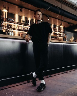 Black Crew-neck T-shirt Outfits For Men: This combo of a black crew-neck t-shirt and black chinos is proof that a pared down off-duty getup can still be really dapper. If you want to easily dress up your look with shoes, complete this look with a pair of black leather derby shoes.