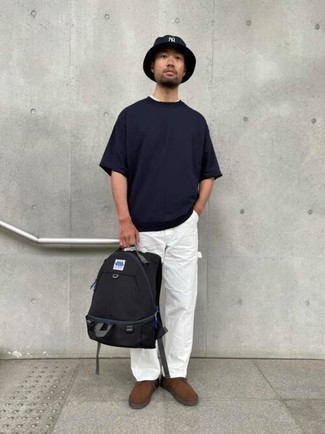 Black Canvas Backpack Outfits For Men: Uber dapper, this combination of a navy crew-neck t-shirt and a black canvas backpack provides wonderful styling opportunities. Play up the classiness of your outfit a bit by wearing a pair of brown suede desert boots.