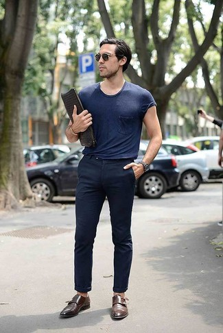 How to wear: navy crew-neck t-shirt, navy chinos, brown leather double monks, black woven leather zip pouch