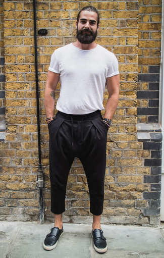 How to Wear Black Leather Double Monks: If you like casual outfits, why not opt for this combo of a white crew-neck t-shirt and black chinos? Let your styling chops really shine by finishing this look with black leather double monks.