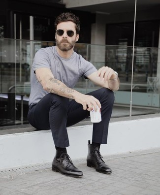 How to Wear Black Leather Dress Boots For Men: Dial down on the formality in this functional combo of a grey crew-neck t-shirt and black chinos. For a dressier vibe, complement your look with black leather dress boots. All in all, a good demonstration of smart casual fashion for 30-something Millennial gentlemen.
