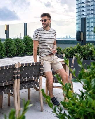 How to wear: white and navy horizontal striped crew-neck t-shirt, beige chinos, navy canvas espadrilles, brown leather belt