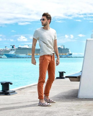 How to wear: white crew-neck t-shirt, orange chinos, white horizontal striped canvas espadrilles, white woven canvas belt