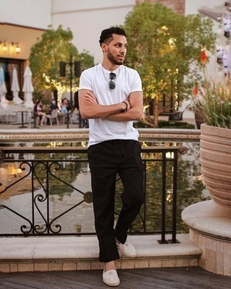 Dark Brown Beaded Bracelet Outfits For Men: This relaxed casual pairing of a white crew-neck t-shirt and a dark brown beaded bracelet is extremely versatile and up for whatever the day throws at you. Serve a little outfit-mixing magic by finishing with grey horizontal striped canvas espadrilles.
