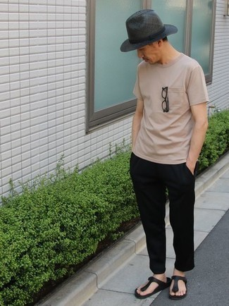 How to Wear Flip Flops For Men: A beige crew-neck t-shirt and black chinos have become an essential combo for many style-conscious gents. On the fence about how to round off? Add flip flops to your outfit to jazz things up.