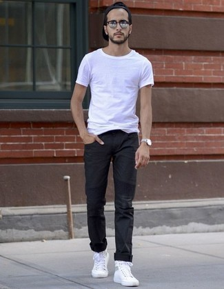 How to wear: white crew-neck t-shirt, black chinos, white canvas high top sneakers, black baseball cap