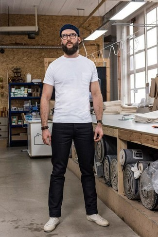 How to Wear a Navy Beanie For Men: Try teaming a white crew-neck t-shirt with a navy beanie to feel completely confident and look stylish. Balance this ensemble with a more elegant kind of shoes, like these beige canvas high top sneakers.
