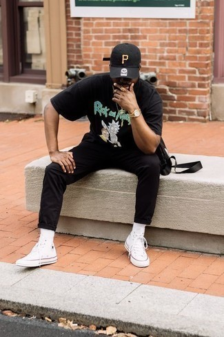 500+ Hot Weather Outfits For Men: If you don't take fashion too seriously, go for casually cool style in a black print crew-neck t-shirt and black chinos. Upgrade this look with a pair of white canvas high top sneakers.