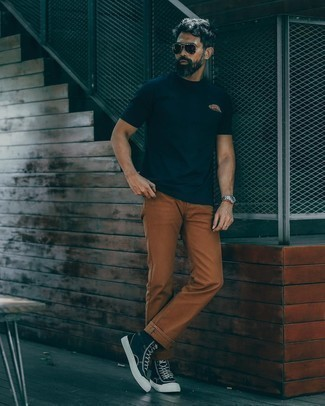 Tobacco Chinos Outfits: Showcase that no-one does casual like you by wearing a navy crew-neck t-shirt and tobacco chinos. For something more on the cool and casual end to round off your outfit, throw a pair of navy and white canvas high top sneakers into the mix.