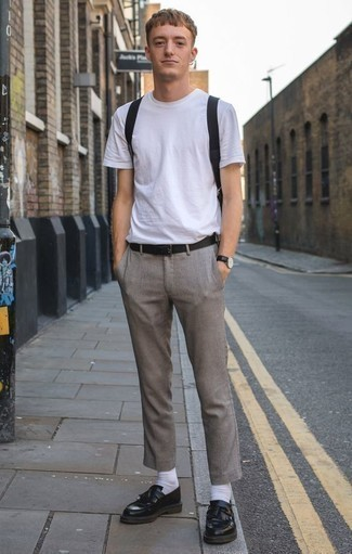 How to Wear a Black Leather Belt For Men: A white crew-neck t-shirt and a black leather belt are the ideal way to infuse played down dapperness into your day-to-day arsenal. Black fringe leather loafers are an easy way to punch up this getup.