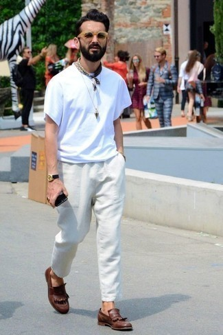 How to Wear White Chinos: A white crew-neck t-shirt and white chinos are great menswear must-haves that will integrate nicely within your current casual lineup. Take a classic approach with shoes and complement this ensemble with brown fringe leather loafers.