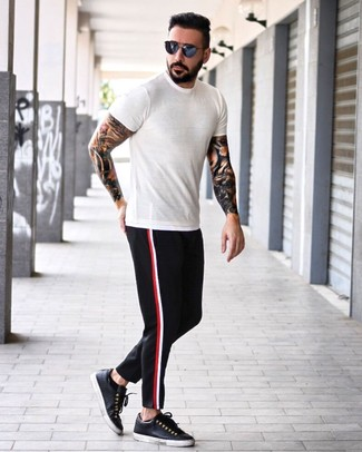 How to wear: white crew-neck t-shirt, black chinos, black leather low top sneakers, navy sunglasses