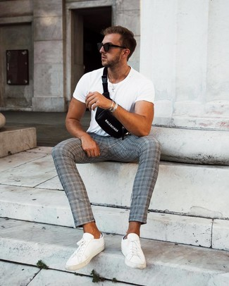 How to Wear a Silver Bracelet For Men: The go-to for laid-back menswear style? A white crew-neck t-shirt with a silver bracelet. Get a little creative in the shoe department and elevate this outfit by wearing white leather low top sneakers.