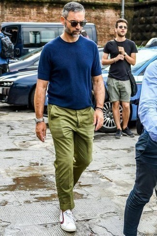 How to Wear Olive Chinos In Summer: Try teaming a navy crew-neck t-shirt with olive chinos for a fuss-free outfit that's also put together. If you're wondering how to round off, complement your outfit with white and red low top sneakers. This ensemble is a goofproof option if you're after a great, summer-appropriate ensemble.