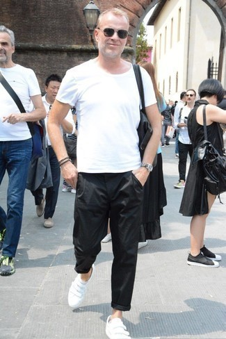How to Wear Black Chinos: This combination of a white crew-neck t-shirt and black chinos is on the casual side yet it's also on-trend and seriously sharp. Introduce a pair of white leather low top sneakers to the equation for maximum effect.