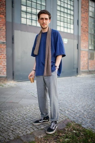 How to Wear a Dark Brown Print Scarf For Men: You'll be amazed at how very easy it is for any gentleman to throw together this a street style ensemble. Just a navy crew-neck t-shirt and a dark brown print scarf. Black and white canvas low top sneakers will easily class up even the most basic of looks.
