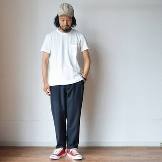 How to Wear a Grey Baseball Cap For Men: This is solid proof that a white crew-neck t-shirt and a grey baseball cap look amazing when paired up in a casual street style ensemble. Complete your look with red canvas low top sneakers to immediately up the fashion factor of this look.