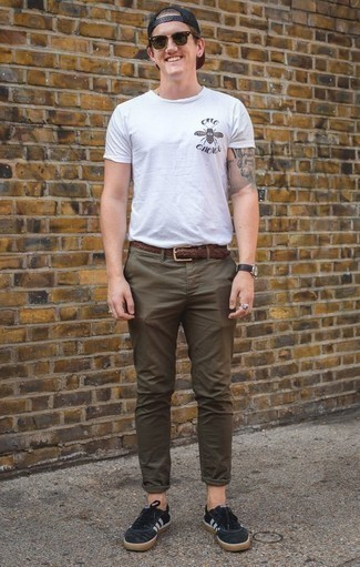 How to Wear a Brown Woven Leather Belt For Men: This combination of a white print crew-neck t-shirt and a brown woven leather belt is on the off-duty side yet it's also sharp and really dapper. Navy suede low top sneakers are a fail-safe way to bring an added dose of style to your getup.