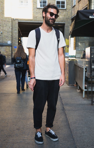 How to Wear Dark Green Sunglasses For Men: If you're all about comfort dressing when it comes to your personal style, you'll love this bold casual combination of a white crew-neck t-shirt and dark green sunglasses. Black and white suede low top sneakers will polish off any ensemble.