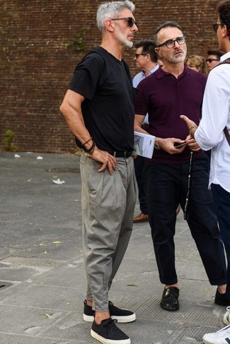 Men's Looks & Outfits: What To Wear Casually: This is solid proof that a black crew-neck t-shirt and grey chinos look awesome when worn together in a casual look. For extra fashion points, add black and white canvas low top sneakers to this ensemble.