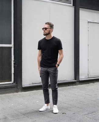 How to Wear Low Top Sneakers For Men: Extra stylish and functional, this casual combo of a black crew-neck t-shirt and charcoal chinos provides with countless styling opportunities. Introduce a pair of low top sneakers to your outfit et voila, this ensemble is complete.