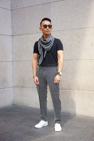 How to Wear a Grey Scarf For Men: A black crew-neck t-shirt and a grey scarf are among the crucial pieces in any modern gentleman's great casual sartorial collection. Complement this outfit with white canvas low top sneakers to effortlessly ramp up the classy factor of this ensemble.