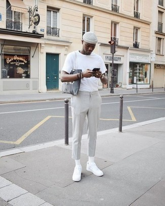 Grey Chinos Outfits: A white crew-neck t-shirt and grey chinos? This is easily a wearable look that anyone can rock on a daily basis. White canvas low top sneakers pull the look together.