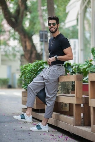 Black Leather Belt Outfits For Men: For a casual and cool ensemble, reach for a black crew-neck t-shirt and a black leather belt — these two pieces fit really well together. Introduce a pair of white and green leather low top sneakers to the equation for extra style points.